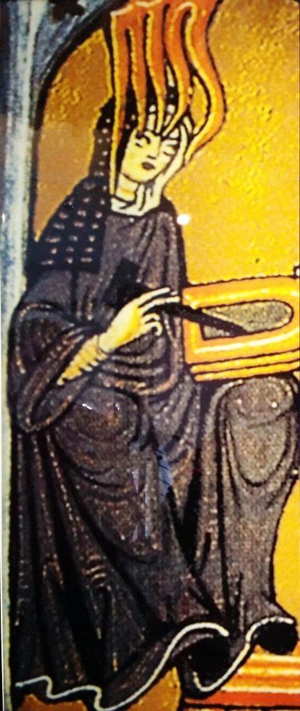 """Ilustracja ze """"Scivias"""" przedstawiająca Hildegardę zapisującą na tabliczce treści, które otrzymuje z góry pod wpływem Bożego natchnienia."""